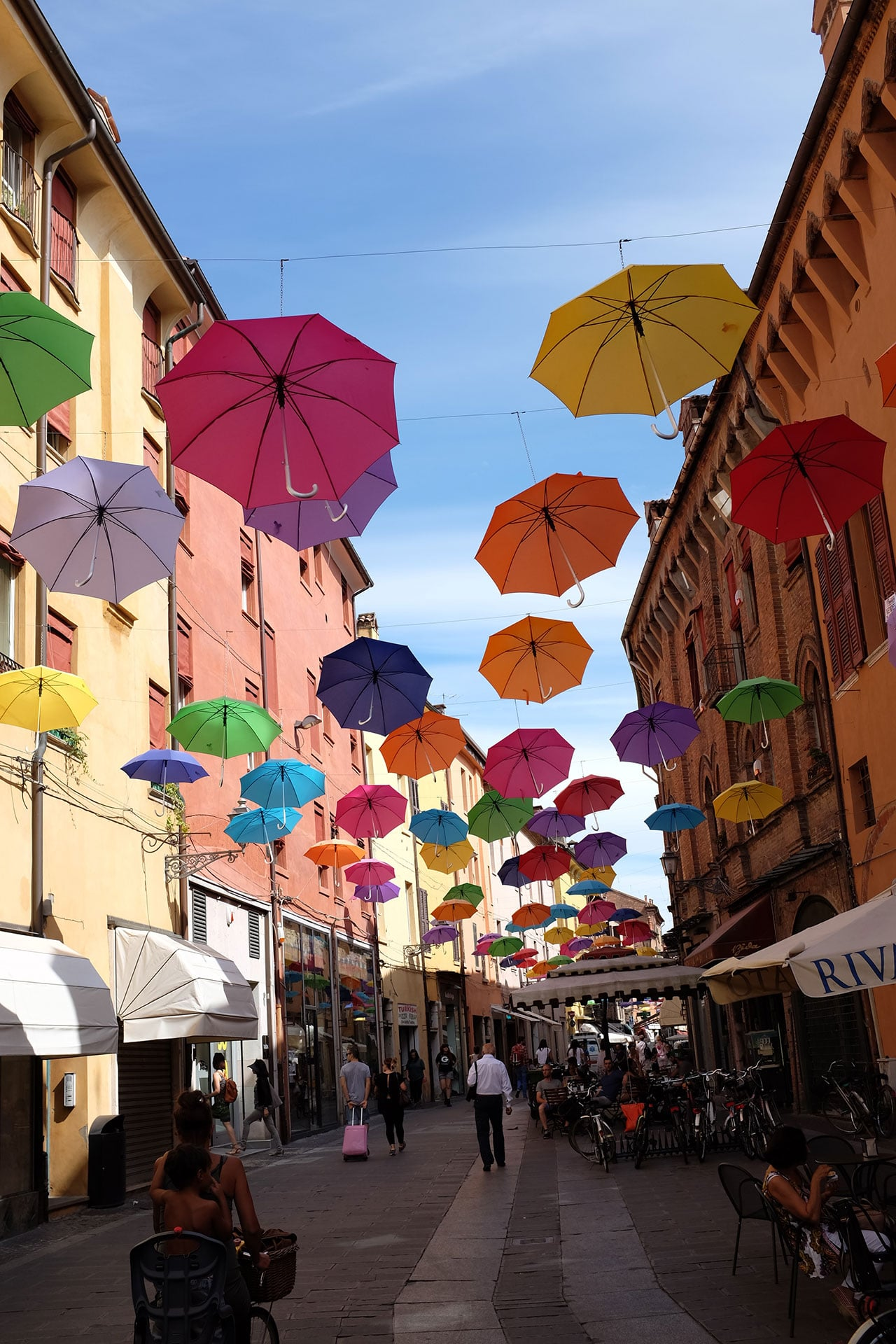 streets filled with umbrellas italy
